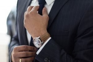 recruiter tightening up tie know in business suit with nice watch
